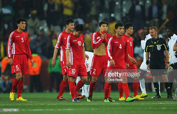 The dejected North Korea team after defeat and elimination from the tournament during the 2010 FIFA World Cup South Africa Group G match between...
