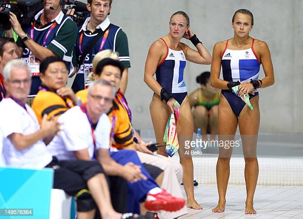 The dejected pair Sarah Barrow and Tonia Couch of Great Britain look on after finishing in fifth place ahead of the Women's Synchronised 10m Platform...