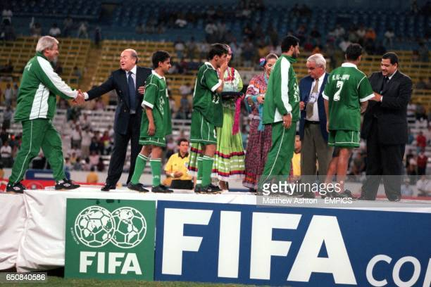 The dejected Saudi Arabia team are congratulated after finishing fourth in the FIFA Confederations Cup