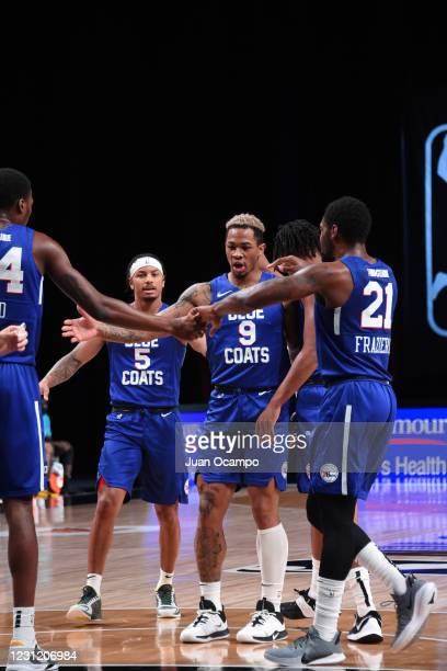 The Delaware Blue Coats high-fives each other during the game on February 16, 2021 at AdventHealth Arena in Orlando, Florida. NOTE TO USER: User...