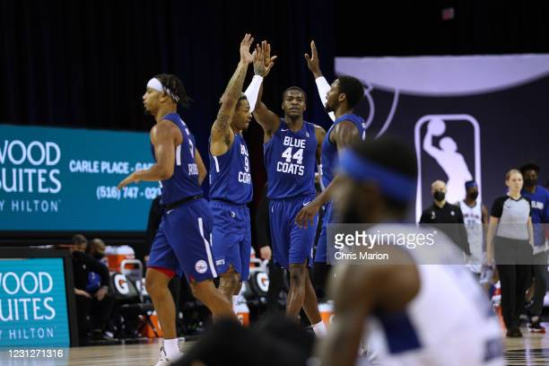 The Delaware Blue Coats high-fives each other during the game on February 19, 2021 at HP Field House in Orlando, Florida. NOTE TO USER: User...
