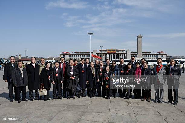 The delegation poses for a picture in front of the National Museum of China before the Second plenary session of the National People's Congress on...