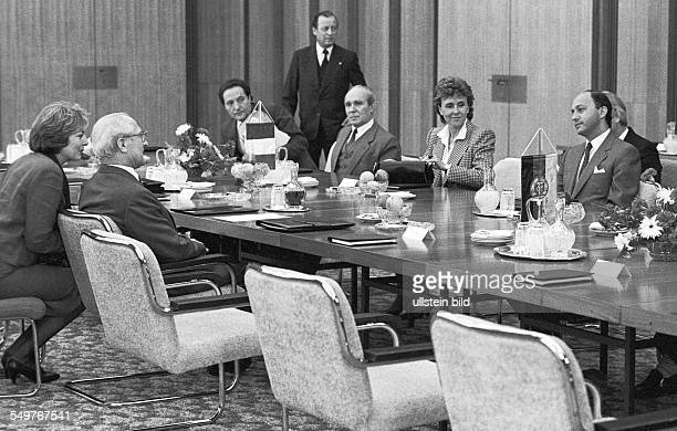 The delegations at the negotiating table in the State Council building in East Berlin from right French Prime Minister Laurent Fabius Edith Cresson...