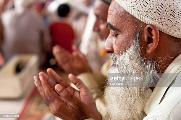 The delicate moments for a Muslim when he pray to God with due loyalty & piety after performing the prayers at mosque.