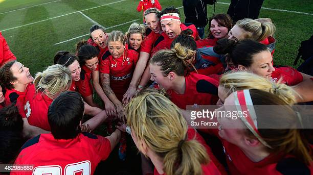 The delighted Wales team celebrate after the Six Nations championship match between Wales and England at St Helens RFC on February 8, 2015 in...