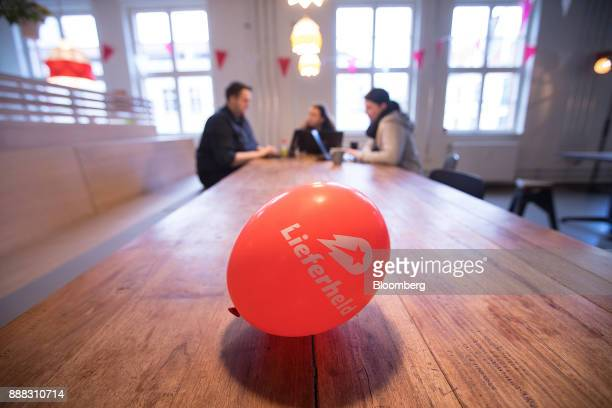 The Delivery Hero AG logo sits on an balloon as employees work inside the company's headquarter offices in Berlin Germany on Friday Dec 8 2017...