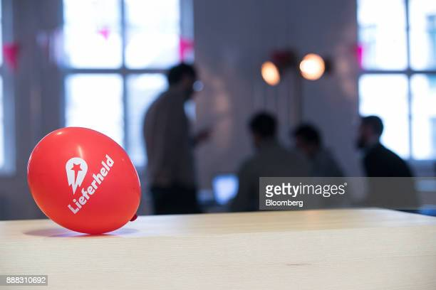 The Delivery Hero AG logo sits on an balloon inside the company's headquarter offices in Berlin Germany on Friday Dec 8 2017 Delivery Hero competes...