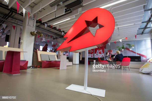 The Delivery Hero AG logo stands inside the company's headquarters in Berlin Germany on Friday Dec 8 2017 Delivery Hero competes with appbased...