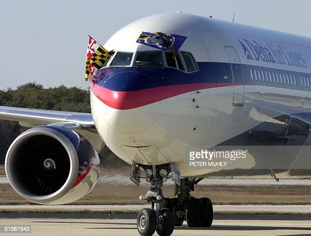 The Delta Airlines flight carrying the Baltimore Ravens arrives at the Tampa International Airport in Tampa 22 January 2001 The Ravens will start...