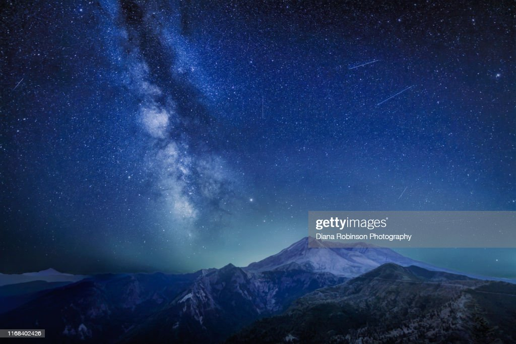 The Delta Aquariids meteor shower and Milky Way over Mount St. Helens, at Windy Ridge in Washington State : Stock Photo