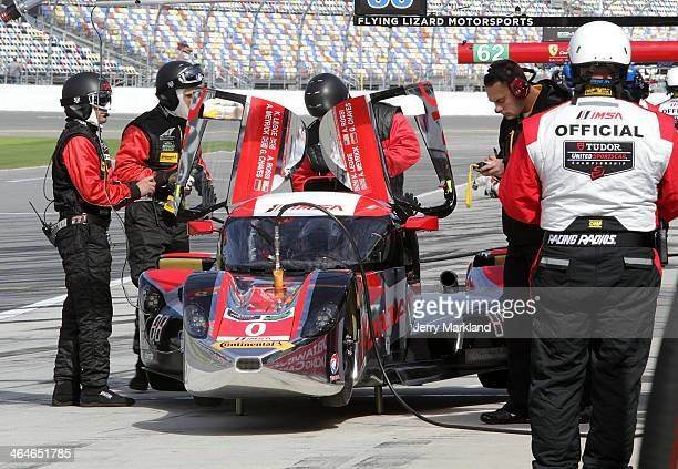 The DeltaWing Racing Cars DeltaWing DWC13 driven by Andy Meyrick Katherine Legge Alexander Rossi and Gabby Chaves waits on pit road during practice...