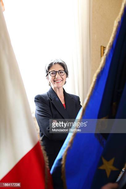 The Democratic Party leader of the Italian Senate Anna Finocchiaro posing smiling between the Italian flag and the European one in her office in...