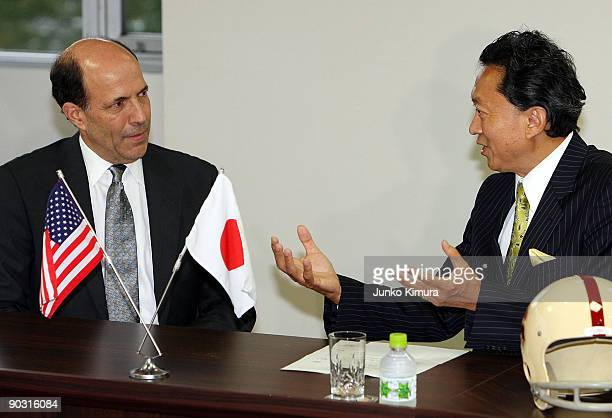 The Democratic Party of Japan President Yukio Hatoyama and U.S. Ambassador to Japan John Roos talk during their meeting at the DPJ headquarters on...