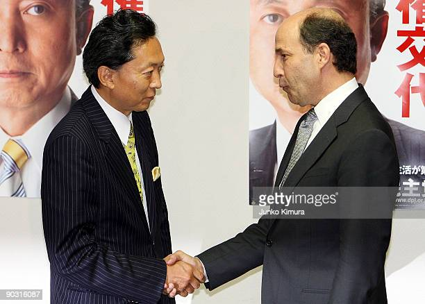 The Democratic Party of Japan President Yukio Hatoyama and U.S. Ambassador to Japan John Roos shakes hands prior to their meeting at the DPJ...
