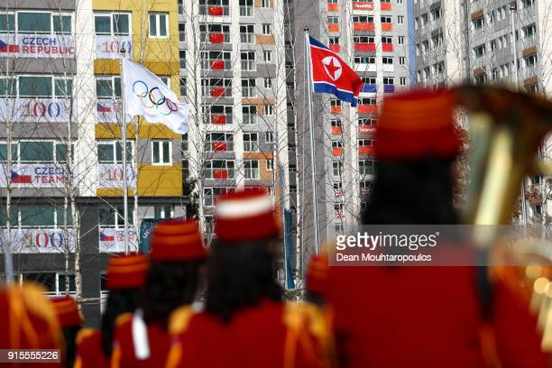 The Democratic People's Republic of Korea flag is raised next to the Olympic flag during the welcome ceremony ahead of the PyeongChang 2018 Winter...