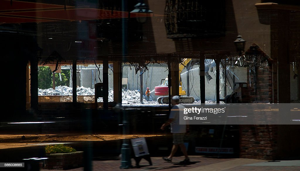 The Demolition Of The Desert Fashion Plaza Is Reflected In A