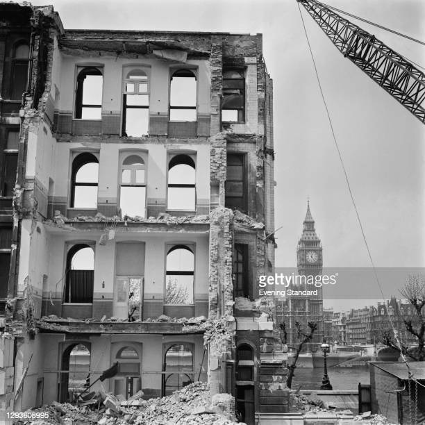 The demolition of the old St Thomas' Hospital, across the River Thames from the Houses of Parliament and Big Ben in London, UK, 6th May 1968.