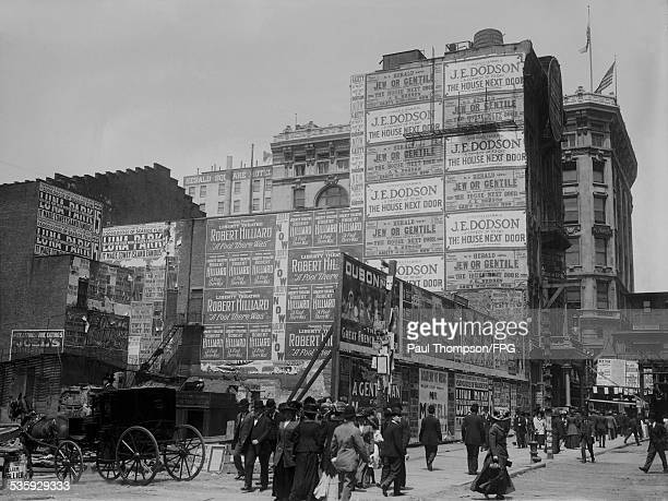 The demolition on the Manhattan Theatre on Sixth Avenue and 33rd Street in New York City, 1909. The posters are advertising J. E. Dodson in 'The...