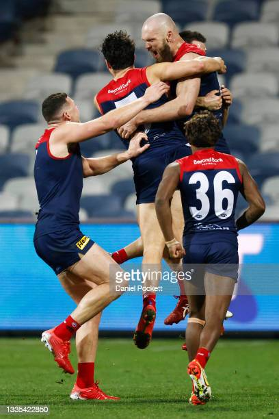 The Demons celebrate a goal to Max Gawn of the Demons after the siren to win the round 23 AFL match between Geelong Cats and Melbourne Demons at...