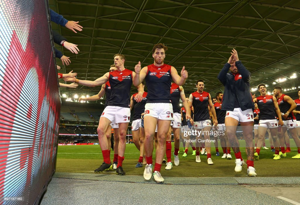 The Demons celebrate after they defeated the Bulldogs during the round 13 AFL match between the Western Bulldogs and the Melbourne Demons at Etihad Stadium on June 18, 2017 in Melbourne, Australia.