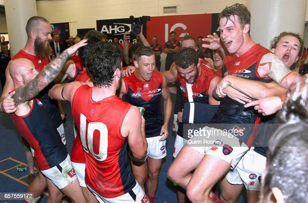 The Demons celebrate in the rooms after winning the round one AFL match between the St Kilda Saints and the Melbourne Demons at Etihad Stadium on...