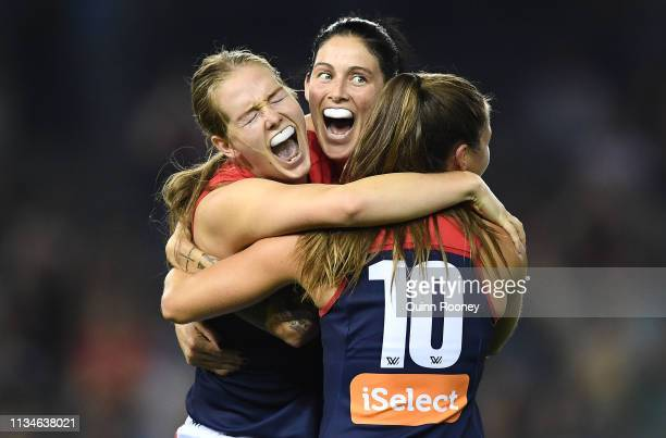 The Demons celebrate winning the round six AFLW match between the Western Bulldogs and the Melbourne Demons at Marvel Stadium on March 09 2019 in...