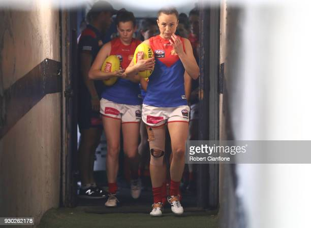 The Demons head out for the start of the round six AFLW match between the Carlton Blues and the Melbourne Demons at Ikon Park on March 11 2018 in...
