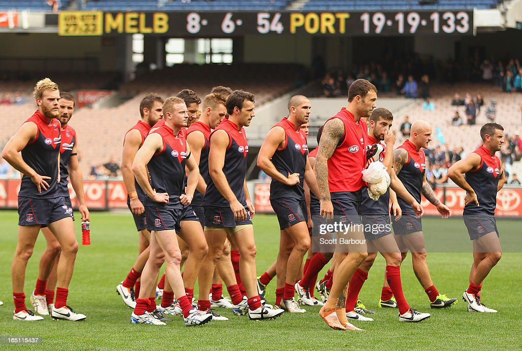 The Demons leave the field after losing the round one AFL match between the Melbourne Demons and Port Adelaide Power at the Melbourne Cricket Ground on March 31, 2013 in Melbourne, Australia.