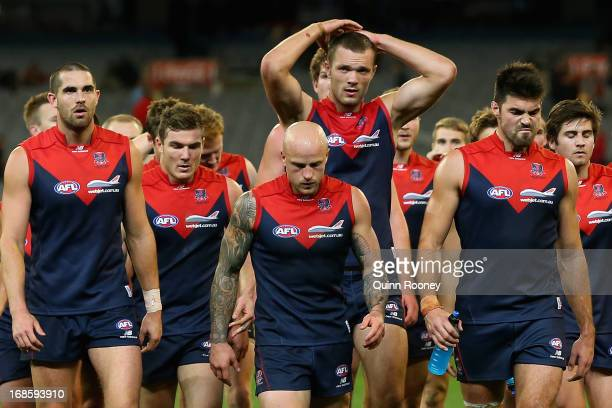 The Demons look dejected after losing the round seven AFL match between the Melbourne Demons and the Gold Coast Suns at Melbourne Cricket Ground on...