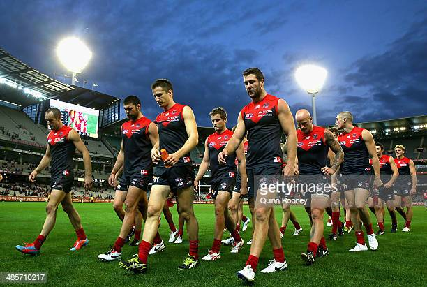 The Demons look dejected as they leave the field after losing the round five AFL match between the Melbourne Demons and the Gold Coast Suns at...