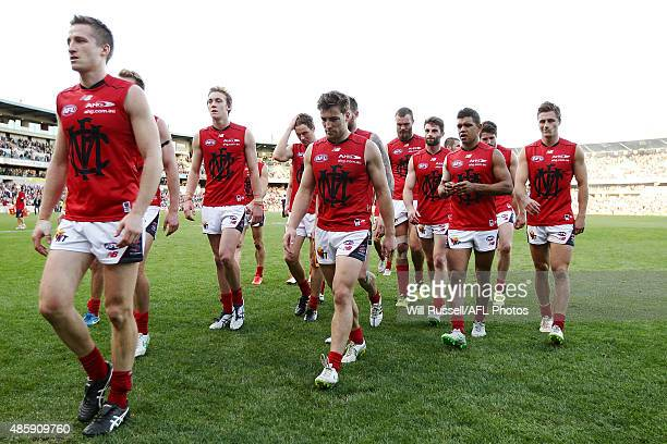 The Demons walk from the field after being defeated during the round 22 AFL match between the Fremantle Dockers and the Melbourne Demons at Domain...