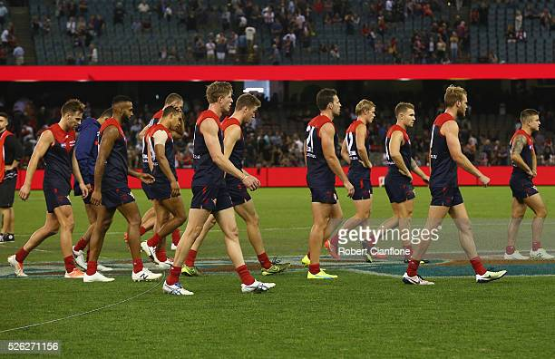 The Demons walk from the ground after they were defeated by the Saints during the round six AFL match between the Melbourne Demons and the St Kilda...
