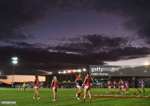 The Demons warm up after half time during the Women's round three match between the Western Bulldogs and the Melbourne Demons at Whitten Oval on...