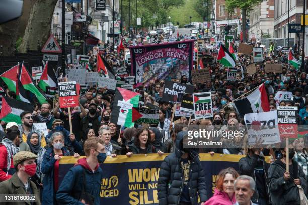 The demonstration proceeds from Hyde Park as tens of thousands of people join a protest march in solidarity with Palestine to the Israeli Embassy on...