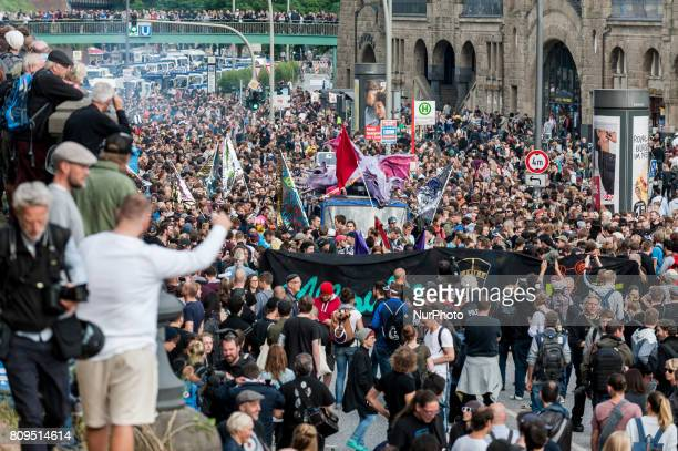 The demonstration starts to move About 20000 people demonstrated in a march with several music cars against the G20 summit At the G20 Summit in...