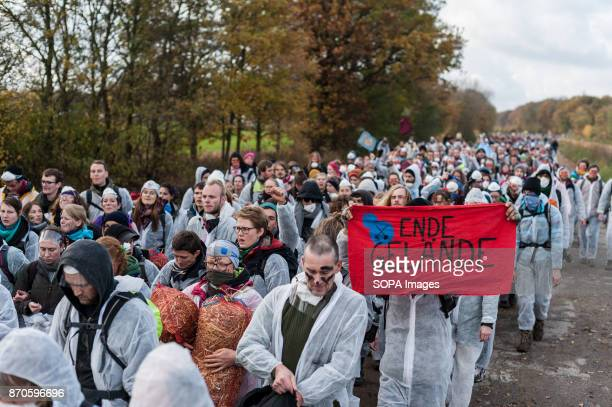 The demonstrators seen walking in the direction of lignite mining Approximately 2500 activists invaded the pit of the lignite open cast mine Hambach...