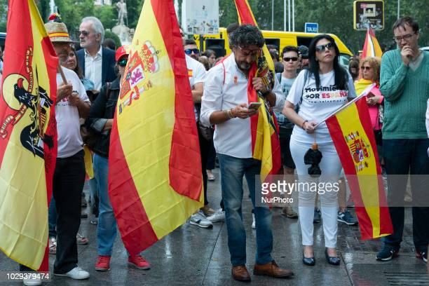 The demonstrators show flags of Spain during the demonstration to show their rejection to the exhumation of the dictator Francisco Franco of the...