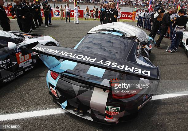 The Dempsey Proton Racing Porsche driven by Patrick Dempsey Patrick Long and Marco Seefried is seen on the grid before the Le Mans 24 Hour race at...