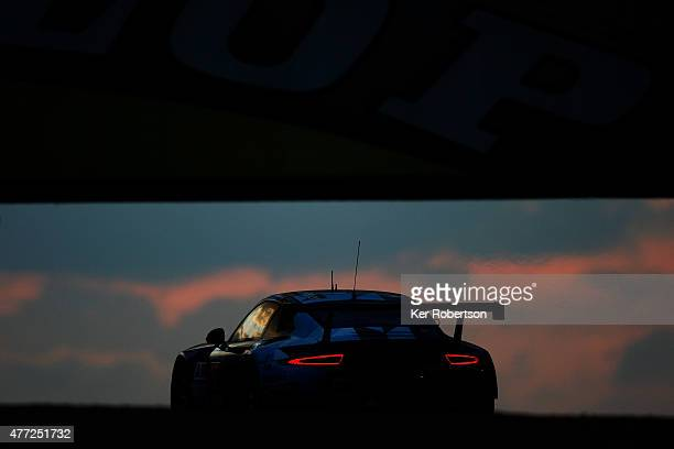The Dempsey Proton Racing Porsche driven by Patrick Dempsey, Patrick Long and Marco Seefried drives under the Dunlop Bridge during the Le Mans 24...