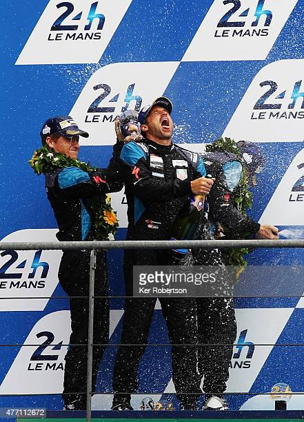 The Dempsey Proton Racing Porsche driver and actor Patrick Dempsey celebrates on the podium after finishing second in the LM GTE Am class with team...
