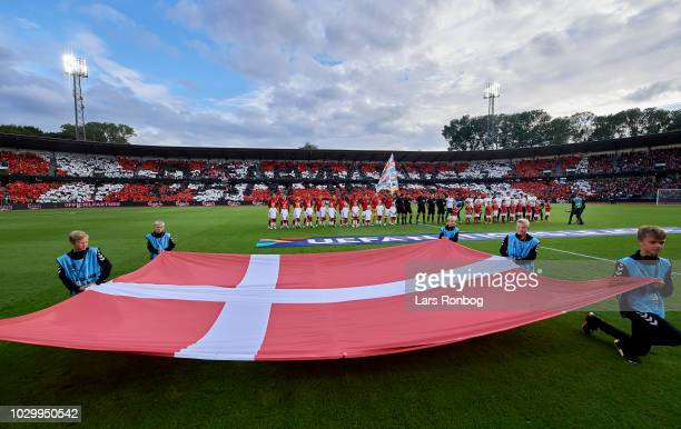 The Denmark players during the national anthems prior to the UEFA Nations League match between Denmark and Wales at Ceres Park on September 9 2018 in...