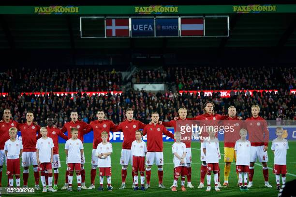 The Denmark players line up during the national anthem prior to the international friendly match between Denmark and Austria at MCH Arena on October...