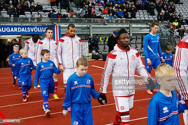 The Denmark players walk out before the UEFA U21 Championship second leg playoff between Iceland and Denmark at the Laugardalsvollur Stadium on...