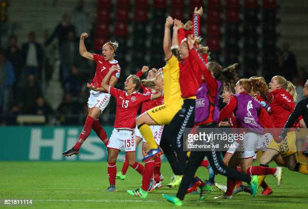 The Denmark team celebrate after the UEFA Women's Euro 2017 match between Norway and Denmark at Stadion De Adelaarshorst on July 24 2017 in Deventer...