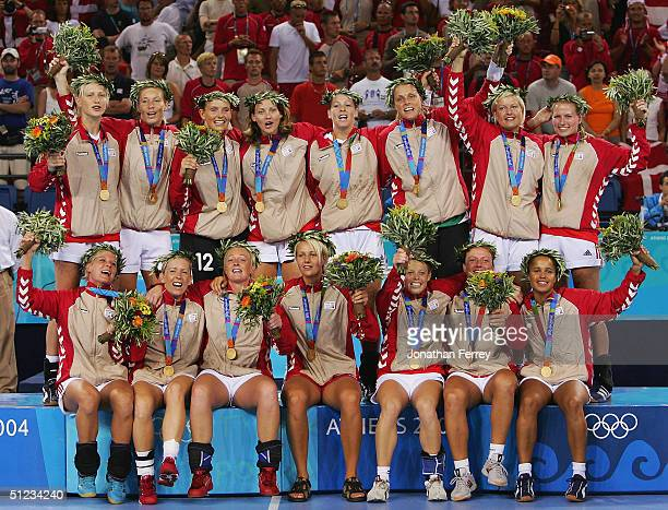 The Denmark team celebrate after wining the gold medal for women's handball on August 29 2004 during the Athens 2004 Summer Olympic Games at the...