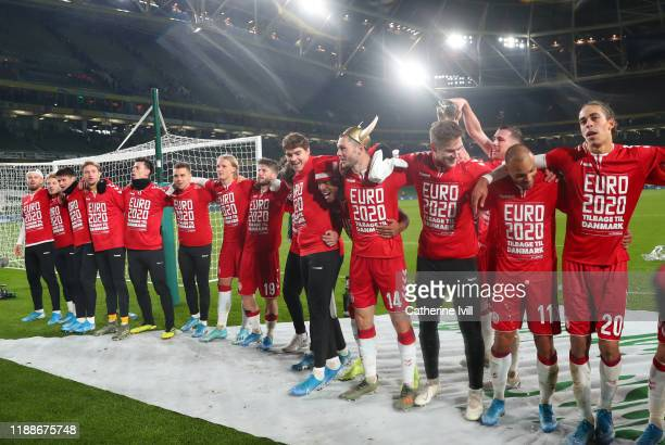 The Denmark team celebrate qualification after the UEFA Euro 2020 qualifier between Republic of Ireland and Denmark so at Dublin Arena on November...