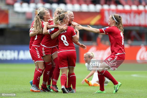 The Denmark team celebrate victory after the UEFA Women's Euro 2017 Quarter Final match between Germany and Denmark at Sparta Stadion on July 30 2017...