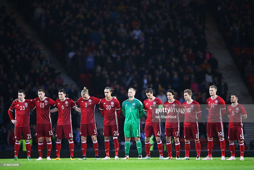 The Denmark team observe a minutes silence during the International Friendly match between Scotland and Denmark at Hampden Park on March 29, 2016 in Glasgow, Scotland.