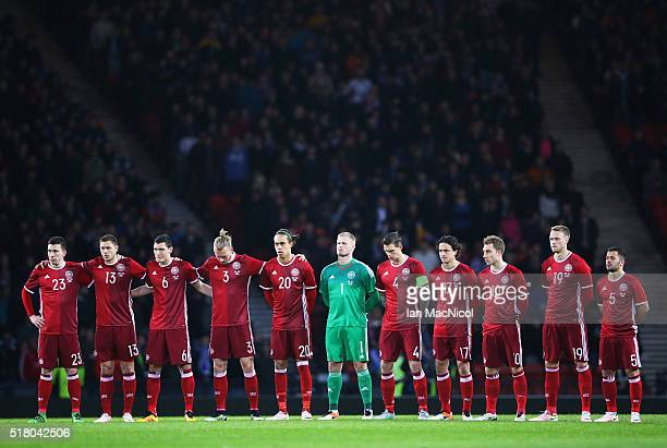 The Denmark team observe a minutes silence during the International Friendly match between Scotland and Denmark at Hampden Park on March 29 2016 in...