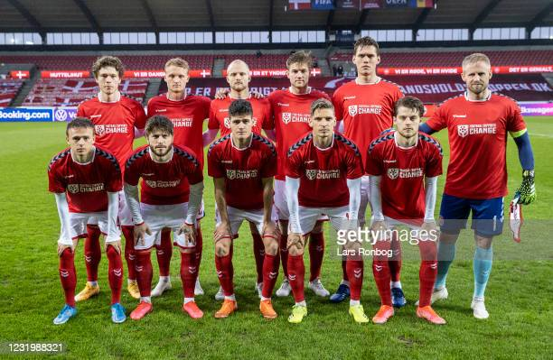 The Denmark team pose for a group picture with special Football Supports Change shirts on prior to the FIFA World Cup 2022 Qatar qualifying match...